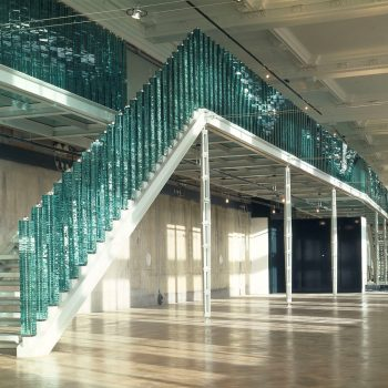 staircase with green balustrades
