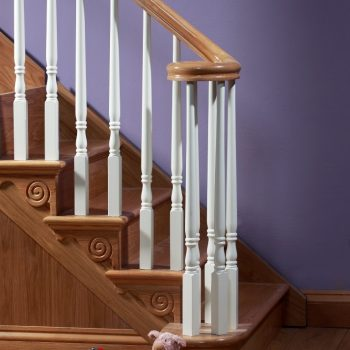 wooden staircase with white railing