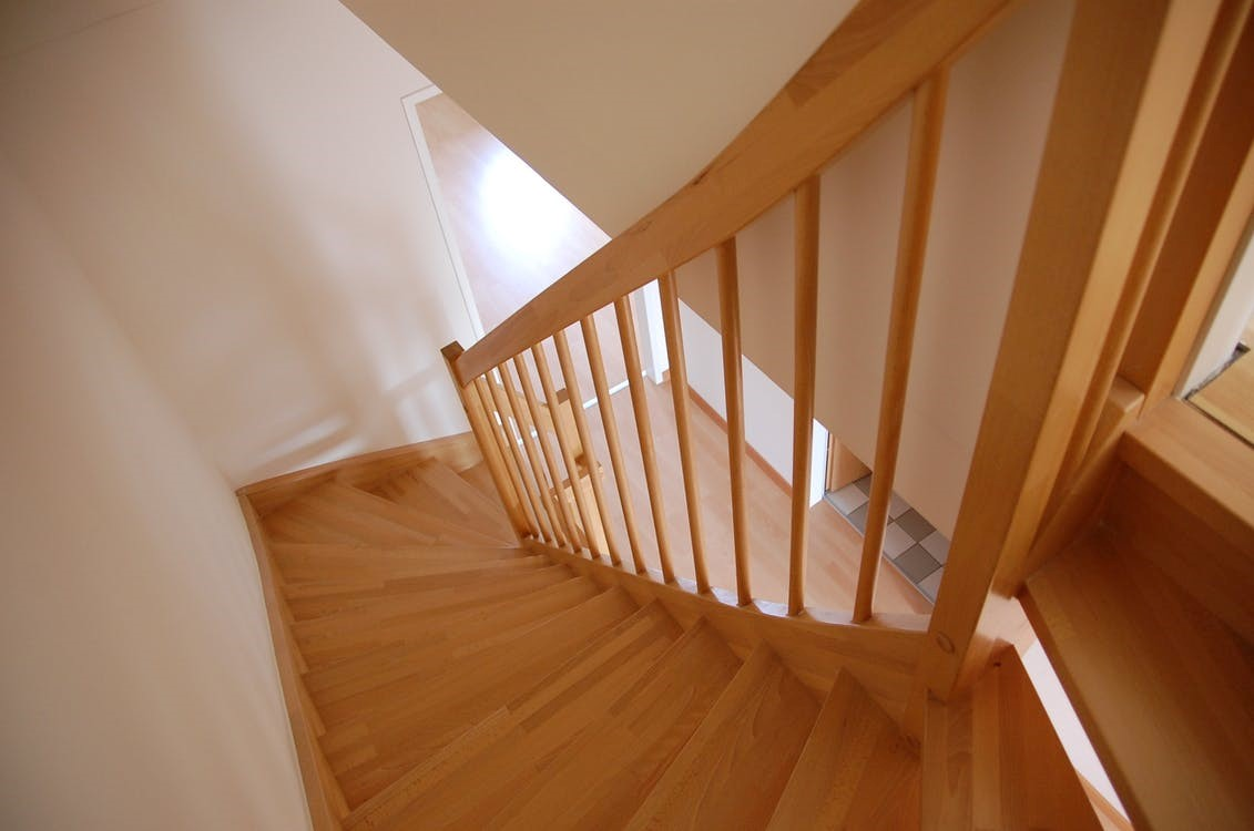 wooden staircase and handrail