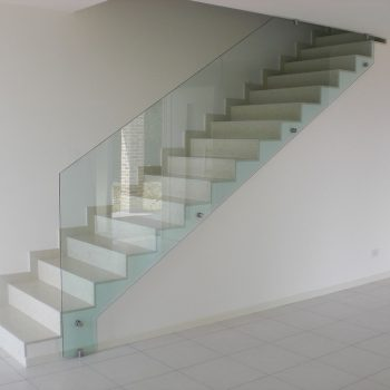 glass balustrade on a white staircase
