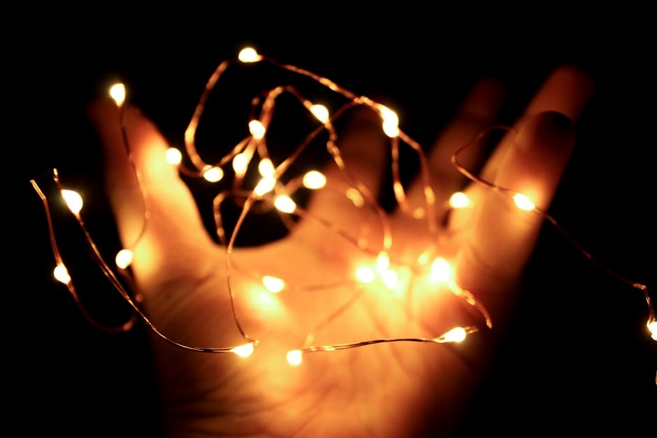 outstretched palm with wire fairy lights