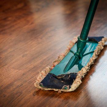 floor mop on wooden floorboards