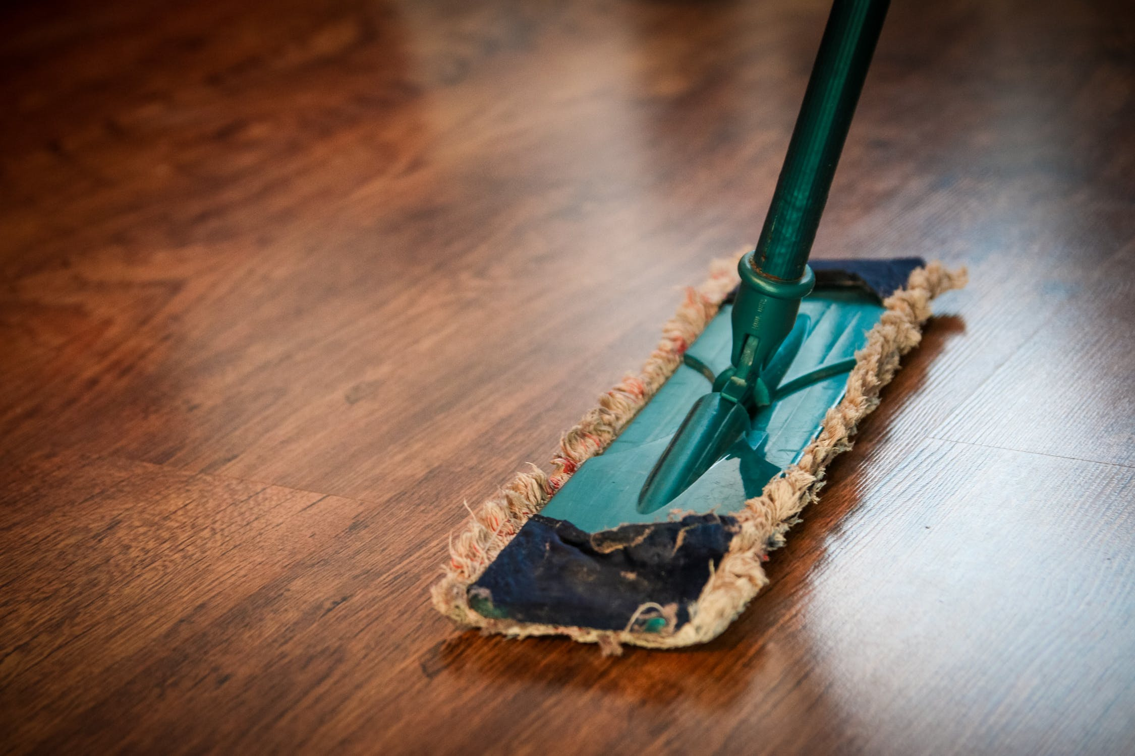 The ultimate spring home maintenance checklist balustrade floor mop on wooden floorboards solutioingenieria Image collections